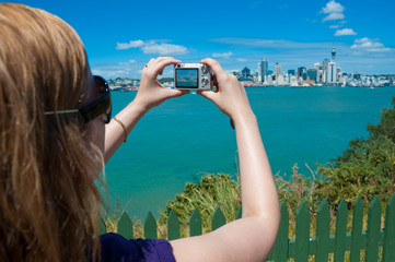 Auckland woman taking picture of skyline