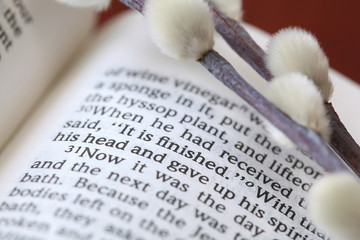 """Open Bible with focus on text in John 19:30: """"It is finished"""""""