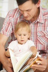 Father and baby reading book