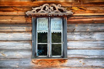 Antique window in  wooden wall