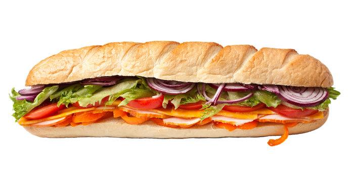 long baguette sandwich with lettuce, slices of fresh vegetables,