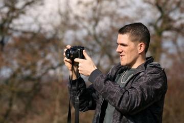 man takes photograph