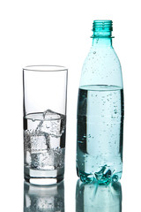 glass of water and bottle isolated