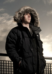 Fashion modeling portrait wearing fur hooded parka coat.