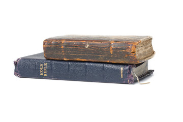 Bible and old book on white background