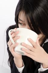 Girl drinking cappuccino