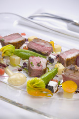 Lamb served with vegetables and sauce