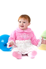 baby playing with colorful balloons