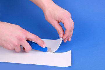 Closeup of hobby knife cutting paper