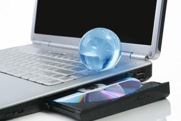 glasses globe on laptop