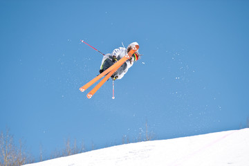 Ski jumper on crystal blue day
