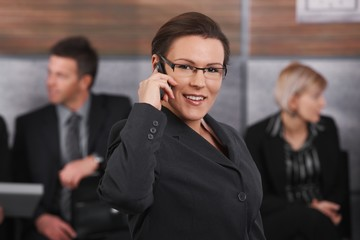 Mid-adult businesswoman talking on mobile