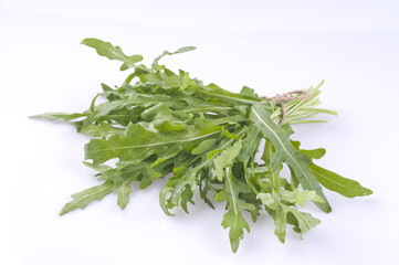 Rucola bunch isolated over white