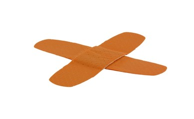 Two adhesive bandages in a cross, isolated on pure white