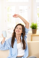 Girl laughing with tea mug in hand