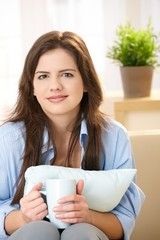 Girl with coffee and pillow