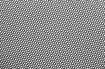 Black metal lattice with round apertures on white background. Cl