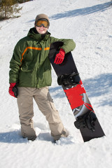 Happy young guy with snowboard