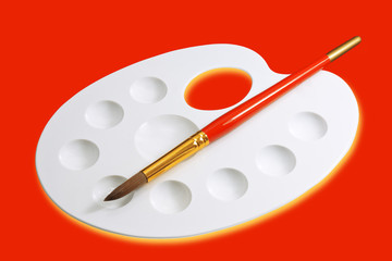 Artist palette and brush isolated on red
