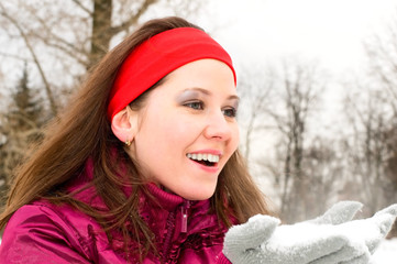 portrait of young smiling woman with snow
