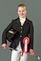 Young girl in riding clothes