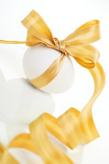 Easter egg with a bow golden