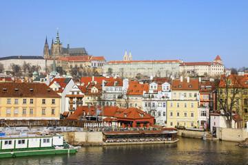 The snowy Prague gothic Castle above the River Vltava