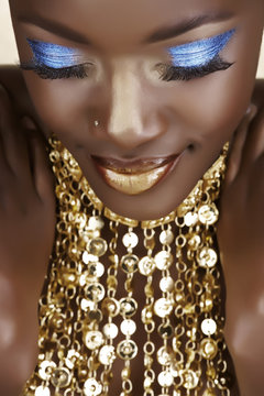 African woman with gold
