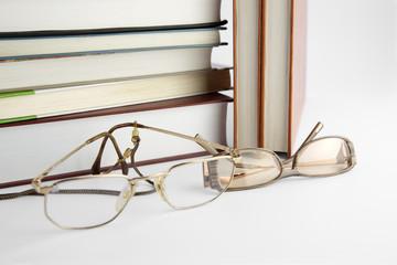 Eyeglasses and books