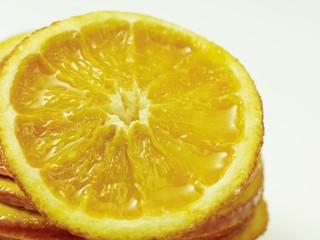 Spoed Foto op Canvas Plakjes fruit Nahaufnahme einer Orangenscheibe