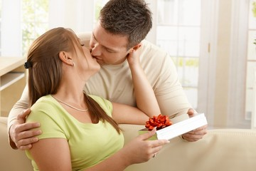 Kissing couple with present