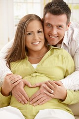 Portrait of expecting couple