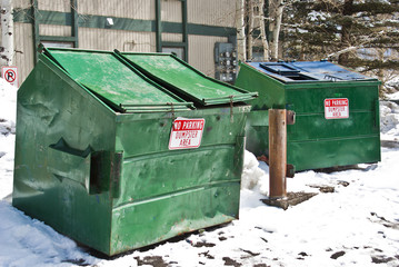 two green dumpsters