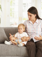 Toddler girl with mother at home