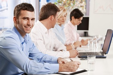 Businessman making notes on presentation