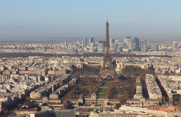 Full view of the Eiffel Tower in Paris with deep blue sky