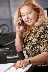 Senior businesswoman on phone