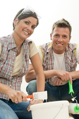 Happy couple with paint brush