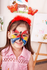 Child preschooler with paint of face. Make up.