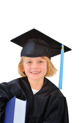 Cute little girl in graduation dress with huge textbook