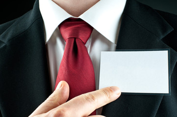 Businessman points on blank nametag