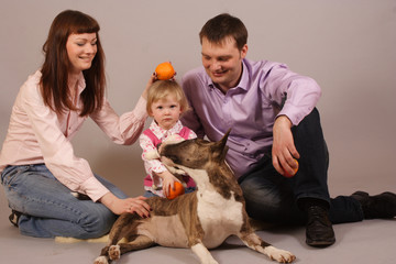 young beautiful family with dog