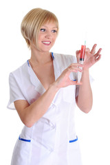 Portrait of the nurse with syringe in hands
