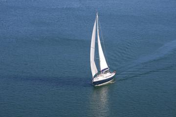Single yacht on blue sea
