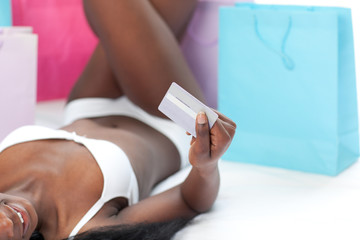 Close-up of a woman holding a credit card