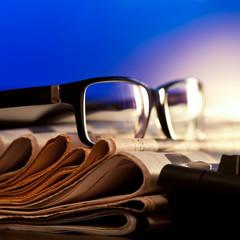 Glasses on newspapers