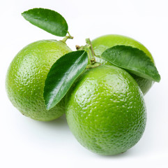Lime with leaves on a white background