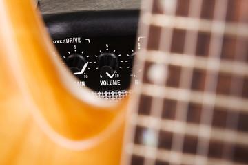 Fotoväggar - Electric guitar with amplifier, focus on volume knob