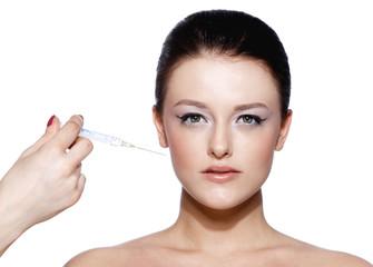 Beautiful woman recieving a botox injection