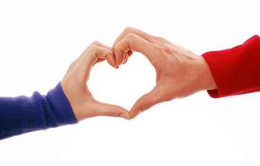 Heart shape symbol with male and female hands